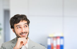 Smiling businessman having an idea Stock Photography