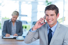 Smiling businessman having a phone call Stock Image