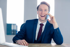 Smiling businessman having a phone call Stock Images