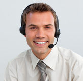 Smiling businessman with a headset on Stock Photo