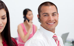 Smiling businessman with headset on Royalty Free Stock Photos