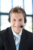 Smiling businessman with a headset on Stock Image