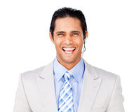 Smiling businessman with headset on against Royalty Free Stock Photography