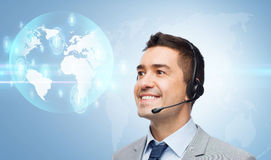 Smiling businessman in headset Stock Photography
