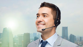 Smiling businessman in headset Stock Photos