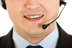 Smiling businessman with headset. Close-up. Stock Images