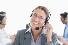 Smiling businessman with headsets looking at camera Stock Image