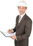 Smiling businessman in helmet Stock Image