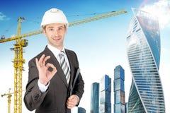 Smiling businessman in helmet Stock Photo