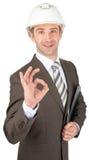 Smiling businessman in helmet Stock Images