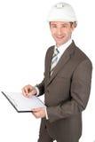 Smiling businessman in helmet Royalty Free Stock Photos