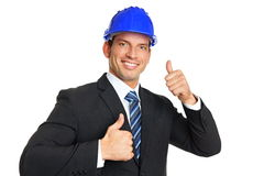 Smiling businessman in a helmet Royalty Free Stock Image