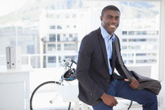 Smiling businessman with his bicycle Royalty Free Stock Image