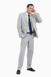 Smiling businessman on his cellphone Royalty Free Stock Images