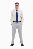 Smiling businessman with his hands in his pockets Stock Image