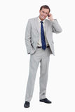 Smiling businessman on his mobile phone Stock Photo