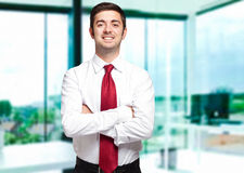 Smiling businessman in his office Royalty Free Stock Images