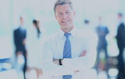 Portrait of happy smiling businessman in a modern office. Smiling businessman in his office Royalty Free Stock Image