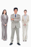 Smiling businessman with his staff behind him Stock Image