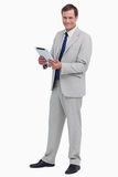Smiling businessman with his tablet computer Royalty Free Stock Photos