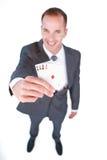 Smiling businessman holding aces Stock Photo