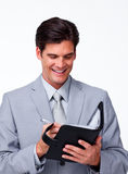 Smiling businessman holding an agenda Royalty Free Stock Photos