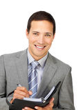 Smiling businessman holding an agenda Stock Photo