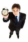 Smiling  businessman holding alarm clock in hand Stock Image