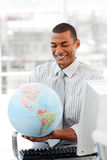 Smiling businessman holding aterrestrial globe Stock Images