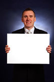 Smiling businessman holding a big blank card Stock Image