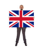 Smiling businessman holding a big card, flag of the United Kingd Stock Images