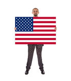 Smiling businessman holding a big card, flag of the United State Stock Image