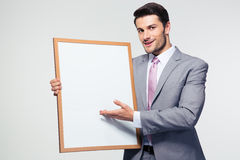 Smiling businessman holding blank board Royalty Free Stock Photo
