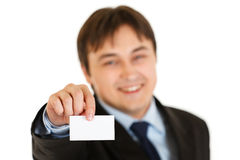Smiling businessman holding blank business card Royalty Free Stock Image