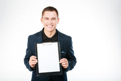 Smiling businessman holding blank clipboard Royalty Free Stock Image