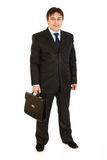 Smiling businessman holding briefcase in hand Royalty Free Stock Photo