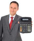 Smiling businessman holding calculator Royalty Free Stock Photos