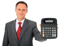 Smiling businessman holding calculator Royalty Free Stock Photography