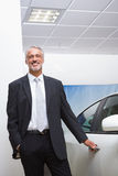 Smiling businessman holding a car door handles Stock Images