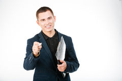 Smiling businessman holding clipboard Stock Images