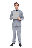 Smiling businessman holding a clipboard Royalty Free Stock Images