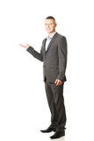 Smiling businessman holding copyspace Royalty Free Stock Image