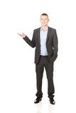Smiling businessman holding copyspace Royalty Free Stock Photography