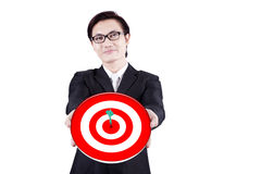 Smiling businessman holding a dartboard Royalty Free Stock Photography
