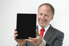 Smiling businessman holding digital tablet Royalty Free Stock Image