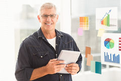 Smiling businessman holding a digital tablet Royalty Free Stock Image