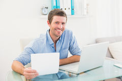 Smiling businessman holding document Stock Images