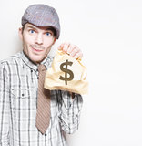 Smiling Businessman Holding Dollar Sign Money Bag Stock Photography