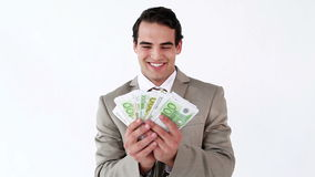 Smiling businessman holding a fan of notes Royalty Free Stock Images