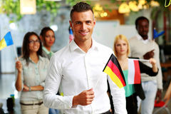Smiling businessman holding flag of Germany Royalty Free Stock Photography